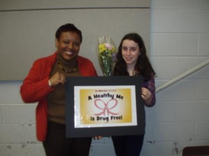 Solon Middle School Principal Genie Green with Red Ribbon Theme Contest Winner Aly Falck